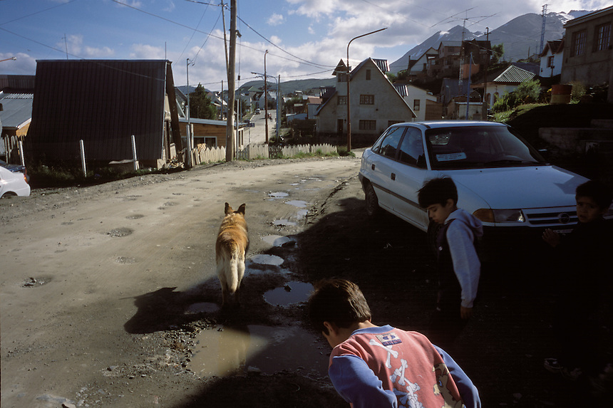 Fueguino boys run the streets of in Ushuaia. Many move to the region hoping for quick economic success before returning home to towns elsewhere in Argentina or Chile. Arriving with an attitude of impermanence, migrants hastily construct poor housing in unplanned neighborhoods.