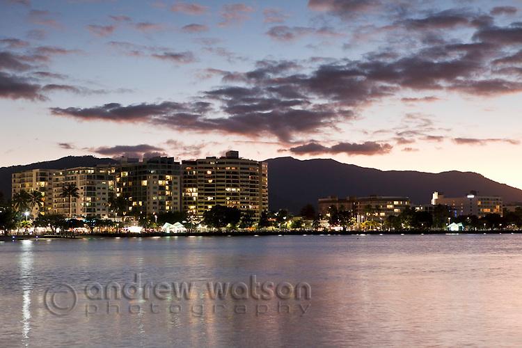 The Esplanade and city skyline at dusk.  Cairns, Queensland, Australia