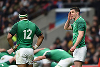 Johnny Sexton of Ireland has a word with team-mate Bundee Aki. Natwest 6 Nations match between England and Ireland on March 17, 2018 at Twickenham Stadium in London, England. Photo by: Patrick Khachfe / Onside Images