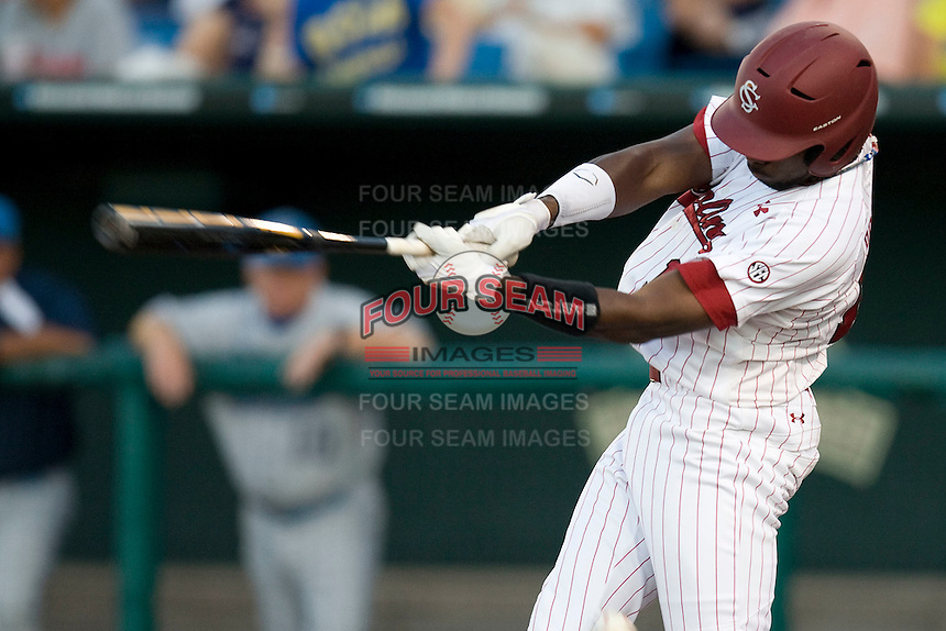South Carolina CF Jackie Bradley Jr swings in Game Two of the NCAA Division One Men's College World Series Finals on June 29th, 2010 at Johnny Rosenblatt Stadium in Omaha, Nebraska.  (Photo by Andrew Woolley / Four Seam Images)