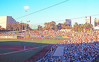 "Ballparks: Sacramento Raley Field. Game time, 7:05 PM, mid-July. To left, ""Money Store""--stepped pyramid; to right, Bridge to I-80."
