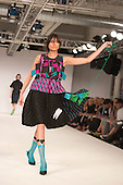 Collection by Lisa Berry from Edinburgh College of Art. Graduate Fashion Week 2014, Runway Show at the Old Truman Brewery in London, United Kingdom. Photo credit: Bettina Strenske