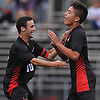 Sebastian Matos #12 of Half Hollow Hills East, right, gets congratulated by teammate Sam Steinberg #10 after scoring a goal midway through the first half of a Suffolk County League II varsity boys soccer game against host Whitman High School on Monday, Sept. 19, 2016. Hills East won by a score of 2-1.
