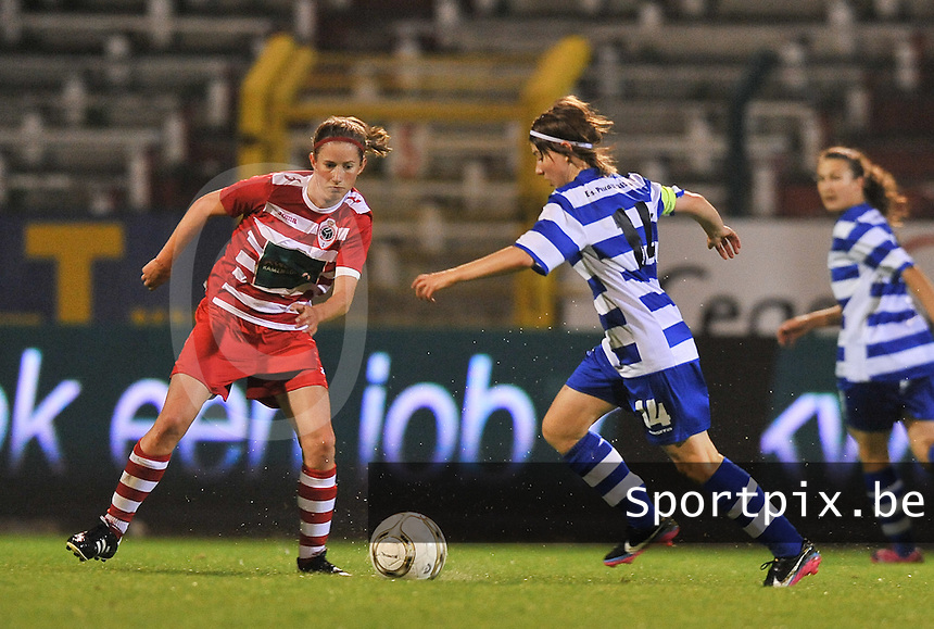 20130913 - ANTWERPEN , BELGIUM : Antwerp Lisa Korevaar (left) pictured defending on Gent's Elke Van De Sompel (right) during the female soccer match between Royal Antwerp FC Vrouwen / Ladies and K AA Gent Ladies at the BOSUIL STADIUM , of the fourth matchday in the BENELEAGUE competition. Friday 13 September 2013. PHOTO DAVID CATRY