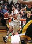 Douglas' Joseph Syammach drives past a Manogue defender in the varsity basketball game at DHS on Tuesday, Jan. 15, 2013. Douglas won 68-49..Photo by Cathleen Allison