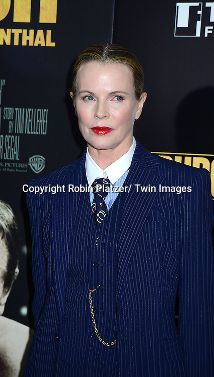 "Kim Basinger in Ralph Lauren blue stripped pants suit attends the World Premiere of ""Grudge Match"" at the Ziegfeld Theatre in New Yok City on December 16, 2013."