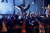 Travis Scott climbs out of a cage during a performance at the 61st annual Grammy Awards on Sunday, Feb. 10, 2019, in Los Angeles. (Photo by Matt Sayles/Invision/AP)