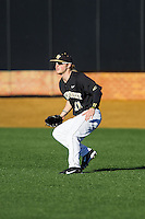 Wake Forest Demon Deacons right fielder Jonathan Pryor (11) on defense against the Missouri Tigers at Wake Forest Baseball Park on February 22, 2014 in Winston-Salem, North Carolina.  The Demon Deacons defeated the Tigers 1-0.  (Brian Westerholt/Four Seam Images)