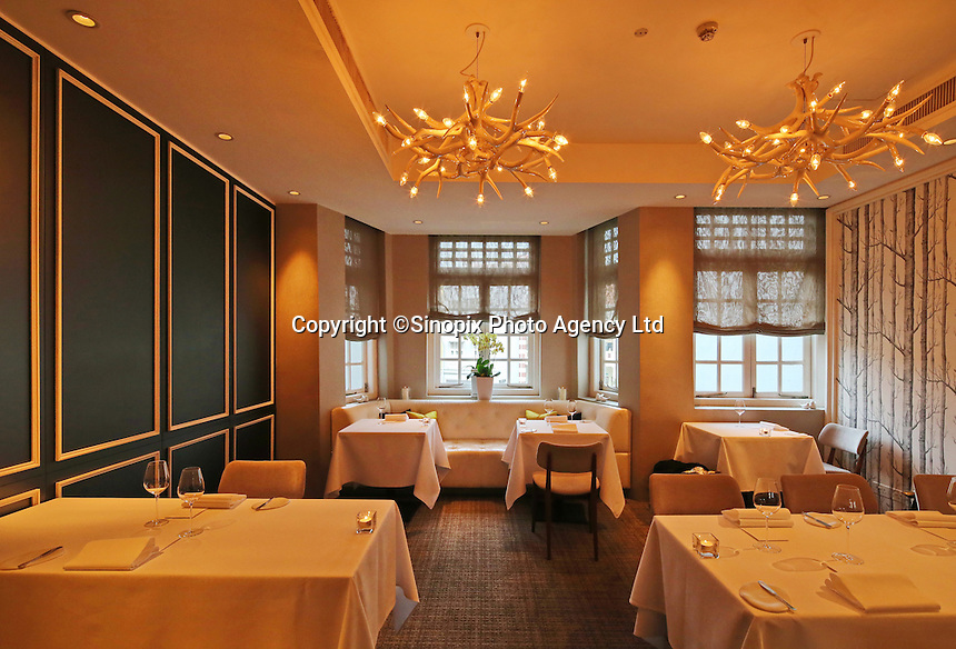 "The interior of Andre's Restaurant built in a traditional ""colonial""s style building in Singapore 13 March 2015."
