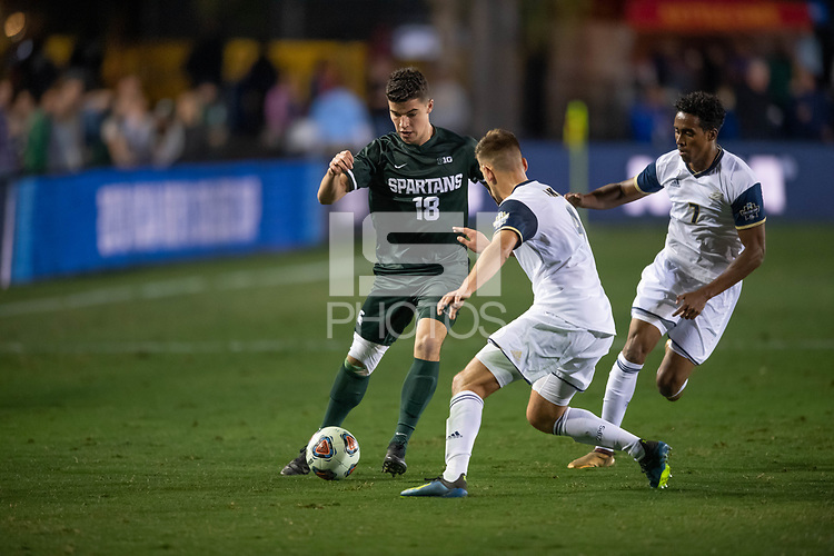 Santa Barbara, CA - Friday, December 7, 2018:  Akron men's soccer defeated Michigan State 5-1 in a semi-final match in the 2018 College Cup.  Michigan State's Michael Miller works against Akron defenders.