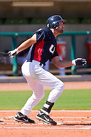 Jordan Danks #15 of the United States World Cup/Pan Am Team follows through on his swing against Team Canada at the USA Baseball National Training Center on September 29, 2011 in Cary, North Carolina.  (Brian Westerholt / Four Seam Images)