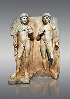Roman Sebasteion relief  sculpture of  Two princes, Aphrodisias Museum, Aphrodisias, Turkey.<br /> <br /> Two princes stand like statues, naked, wearing cloaks. The left figure holds the orb of the world in one hand, a symbol of  world rule that indicates he is the imperial heir, and in the other a ship's stern ornament (aphlaston), a symbol of naval victory. They and probably Gius and Lucius, the grandsons of Augustus, or Nero and Britanicus, Claudius' heir.