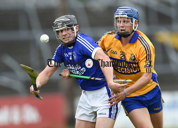 David Ryan of Cratloe in action against Brian Corry of Sixmilebridge during their game in Cusack Park. Photograph by John Kelly.