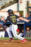Brock Stassi (28) of the Reading Fightin Phils follows through on his swing against the Akron Rubber Ducks at FirstEnergy Stadium on June 19, 2014 in Wappingers Falls, New York.  The Rubber Ducks defeated the Fightin Phils 3-2.  (Brian Westerholt/Four Seam Images)