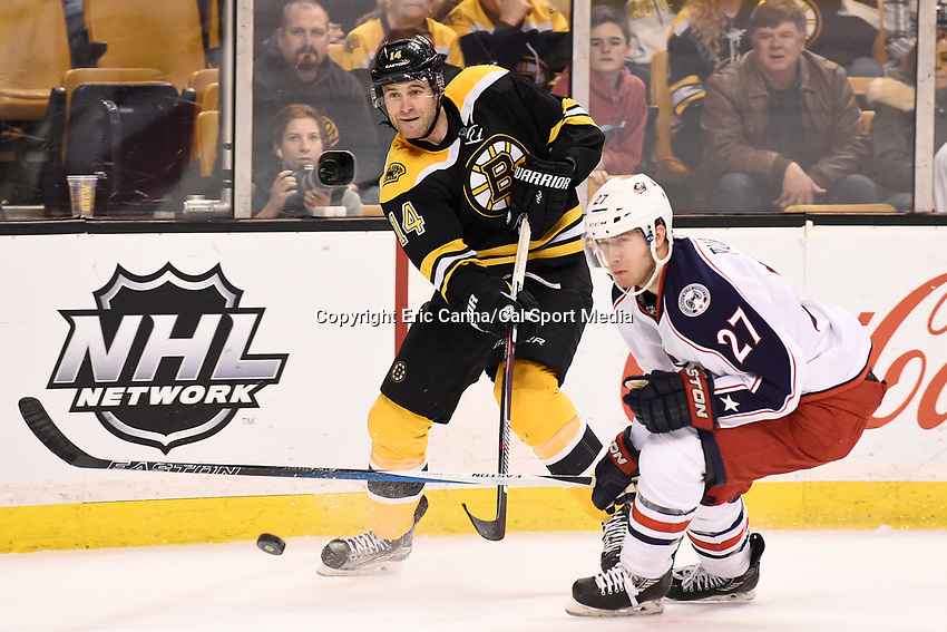 Monday, February 22, 2016: Boston Bruins right wing Brett Connolly (14) shoots the puck at the net during the National Hockey League game between the Columbus Blue Jackets and the Boston Bruins, held at TD Garden, in Boston, Massachusetts. The Blue Jackets defeat the Bruins 6-4. Eric Canha/CSM