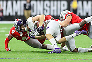 Indianapolis, IN - December 1, 2018: Northwestern Wildcats running back Isaiah Bowser (25) is tackled by several Ohio State Buckeyes defenders during the Big Ten championship game between Northwestern  and Ohio State at Lucas Oil Stadium in Indianapolis, IN.   (Photo by Elliott Brown/Media Images International)