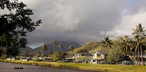 Security forces guard a canal as United States President Barack Obama's motorcade returns to his his vacation compound in Kailua, Hawaii after working out at Marine Corps Base Hawaii on Monday, December 26, 2011. President Obama arrived on December 23 to join First Lady Michele Obama and daughters Sasha and Malia in Hawaii for the winter holidays. .Credit: Kent Nishimura / Pool via CNP