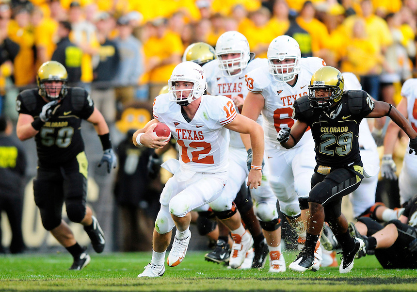 04 October 2008: Texas quarterback Colt McCoy rushes against Colorado. Chasing McCoy is Colorado cornerback Cha'pelle Brown (29). The Texas Longhorns defeated the Colorado Buffaloes 38-14 at Folsom Field in Boulder, Colorado. For Editorial Use Only