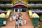 People at Dambulla Buddhist museum complex, Sri Lanka, Asia