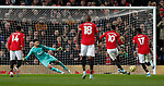 Manchester United's Marcus Rashford (R) scores a penalty during the Premier League match at Old Trafford, Manchester. Picture date: 4th December 2019. Picture credit should read: Darren Staples/Sportimage
