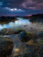 The rocky shoreline of Keahole Point at sunset, Big Island of Hawai'i.