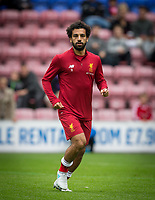 Mohamed Salah of Liverpool during warm up ahead of the pre season friendly match between Wigan Athletic and Liverpool at the DW Stadium, Wigan, England on 14 July 2017. Photo by Andy Rowland.