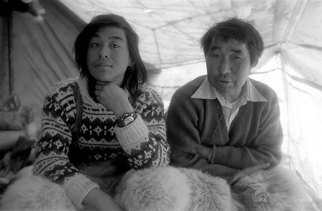 Inuit hunters, Otto Simigak and Kaugunak Qissuk in their tent on a hunting trip. Siorapaluk, Northwest Greenland