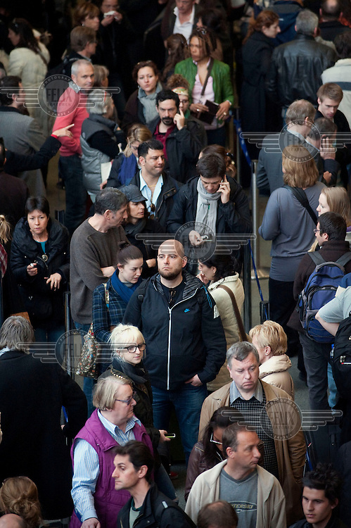 Passengers queue for Eurostar tickets and trains at London St Pancras railway station. With flights suspended due to a volcanic ash cloud, pressure on other transport services had increased.