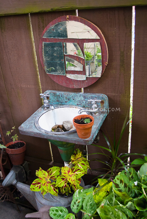 Unexpected tiny water feature using old sink and mirror, pots in containers, small garden, Adorable garden fountain made from an old sink, recycle and reclaim garden