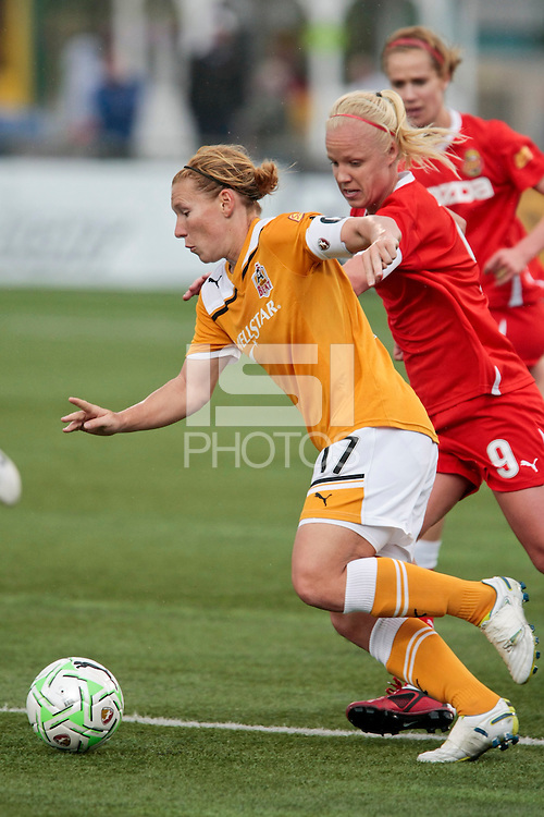 Lori Chalupny (17) of the Atlanta Beat (L) and Caroline Seger (9) of the Western New York Flash battle for the ball during first half action of WPS play at Sahlen's Stadium in Rochester, NY May 01, 2011. New York 3, Atlanta 0.