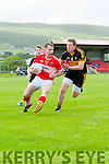 Daingean Uí Chúis Sean B Ó Brosnachain in possession of the ball tackled by Dr. Crokes Andrew Kennelly during the CSFL Div. 1 match Daingean Uí Chúis v Dr. Crokes at Pairc An Aghasaigh, Dingle, on Saturday evening.