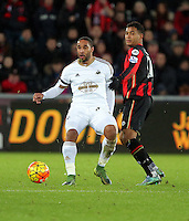 Ashley Williams of Swansea (L) against Joshua King of Bournemouth during the Barclays Premier League match between Swansea City and Bournemouth at the Liberty Stadium, Swansea on November 21 2015