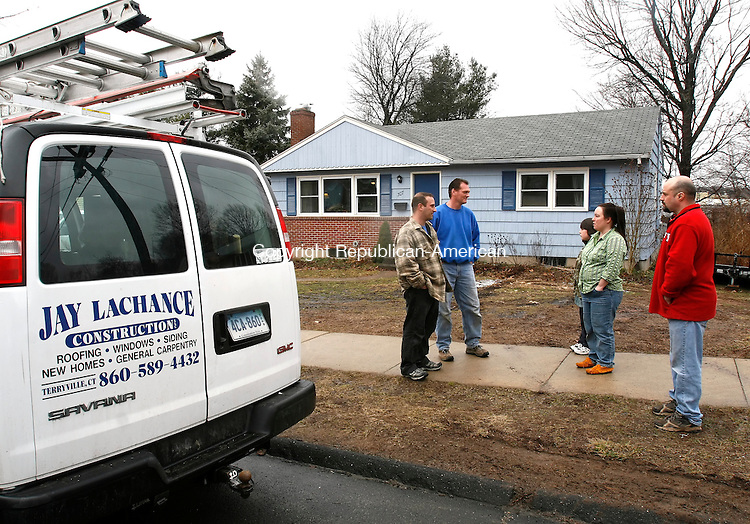 BRISTOL, CT, 03/09/09- 030909BZ01- Chris Raboin and Jay Lachance, of Jay Lachance Construction LLC., talk with Logan, 8, Rickianne and Pierre Levesque outside their Bristol home Monday afternoon.  The roof on the Levesque's home is badly in need of replacement and the Lachance Construction company has donated their services and lined up other volunteers to replace it. <br /> Jamison C. Bazinet Republican-American