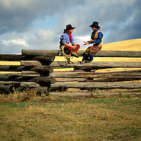 Cowgirl and Cowboy sitting on a Log Rail Fence, British Columbia, Canada (Model Released)