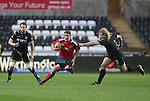 Munster outside half Ian Keatley beats Ospreys prop Duncan Jones for speed.<br /> <br /> RaboDirect Pro12<br /> Ospreys v Munster<br /> Liberty Stadium<br /> 23.02.14<br /> <br /> &copy;Steve Pope-SPORTINGWALES