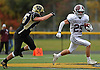 Garden City No. 25 Jamie Atkinson cuts to his left during a Nassau County Conference II varsity fiootball game against host Wantagh High School on Saturday, October 24, 2015. Garden City won by a score of 28-18.<br /> <br /> James Escher