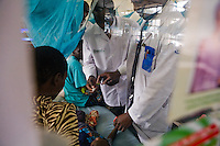 Doctors examine Henry who just  regained consciousness after a battle with Meningitus. Henry is  HIV postive and  a patient in the  Hospital at Homa Bay ,Kenya where MSF runs a clinic to treat HIV..