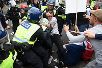 Tommy Robinson supporters arrested after London protest in London, England on June 09, 2018.<br /> **words are for information only and are not for reprint**<br /> A group of Tommy Robinson supporters has blocked off a major road in central London in a tense stand-off with police, who made several arrests.   Hundreds of demonstrators descended on the capital and blocked off the road around Trafalgar Square.  Rows of riot police blocked the gate down the Mall leading to Buckingham Palace, where the Royal Family has gathered on the balcony after celebrating Trooping the Colour just hours earlier.<br /> The protest on Saturday afternoon was the latest in what appears to be a bid to secure the release from jail of the former leader of the English Defence League (EDL).  Supporters chanted &ldquo;Free Tommy Robinson&rdquo; and hurled missiles and smoke bombs at police.  Hundreds of supporters crowded on to an open-top sightseeing bus, waving union flags, while one supporter posed on the roof in a Donald Trump mask.  By 6pm, officers had removed protesters from the bus and had kettled many of the remaining protesters on the traffic island overhead.  Other Robinson supporters crowded on to the steps of Nelson&rsquo;s Column and continued to chant slogans.<br /> A spokesperson for megasightseeing.com said: &ldquo;Our London sightseeing bus was on its normal route when it got caught up in the demonstrations. The bus was stormed by demonstrators, and the driver and a small number of customers got off&hellip;The demonstrators have caused a significant amount of damage to the bus, which meant it had to be towed away. We have reported this to the police, and will help them with any investigations.&rdquo;<br /> Police were significantly outnumbered by demonstrators.<br /> The Metropoltan Police said that as of 6.30pm, one person had been arrested for possession of an offensive weapon, two for assault on a police officer, a fourth for possession of a flare and a fifth for criminal damage to a bus. The Met will now look at CCTV footage of the