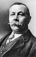 BNPS.co.uk (01202 558833)<br /> Pic: TheHistoryPress/BNPS<br /> <br /> Arthur Conan Doyle <br /> <br /> Sir Arthur Conan Doyle's custom-made portable desk has emerged for sale for £96,000 - and it is as intricate as one of his Sherlock Holmes' plots.<br /> <br /> On first glance it appears to be a standard leather trunk, before folding out to reveal a wooden desk and a bookcase.<br /> <br /> Conan Doyle, a keen traveller, wanted to be able to continue to write wherever he found himself day to day.<br /> <br /> The desk was devised by the French goods maker Goyard for the prolific author in 1925.<br /> <br /> It is being sold by furniture dealer Timothy Oulton, who has a gallery in Chelsea, west London.
