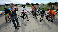 James Stevenson of Rogers (left), who has been riding since 1974, speaks to a group of riders Saturday, Aug. 1, 2020, during a workshop led by Stevenson at the pump track at Runway Bike Park at The Jones Center in Springdale. Stevenson and several local riders spent the morning teaching young riders how to navigate the pump track and how to position themselves on their bicycles. Visit nwaonline.com/200803Daily/ for today's photo gallery.<br /> (NWA Democrat-Gazette/Andy Shupe)