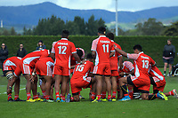 The Tonga team huddles during the international rugby match between  New Zealand Schools Barbarians and Tonga Schools at the Sport and Rugby Institute in Palmerston North, New Zealand on Thursday, 28 September 2017. Photo: Dave Lintott / lintottphoto.co.nz