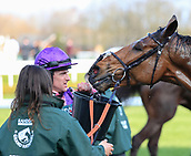 14h April 2018, Aintree Racecourse, Liverpool, England; The 2018 Grand National horse racing festival sponsored by Randox Health, day 3;  Brian Hughes gives his mount Seeyouatmidnight a cooling down after the Grand National