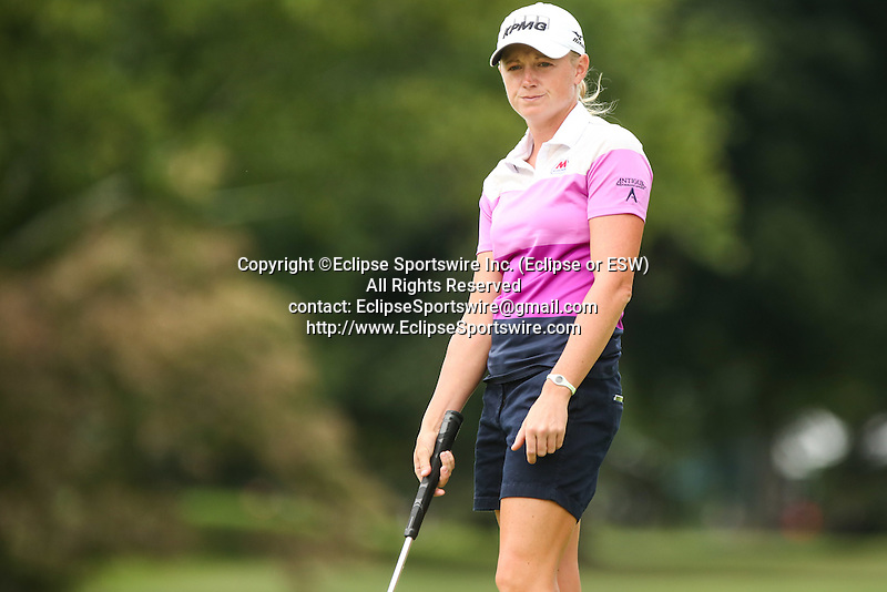 Stacy Lewis reacts after missing her putt on the 10th green at the LPGA Championship 2014 Sponsored By Wegmans at Monroe Golf Club in Pittsford, New York on August 16, 2014