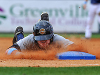Center fielder Ben Gamel (3) of the Charleston RiverDogs slides headfirst into third base in a cloud of dirt in the third inning of a game against the Greenville Drive on June 24, 2012, at Fluor Field at the West End in Greenville, South Carolina. Gamel would later score. The bases were painted blue for colon cancer awareness day. Charleston won, 7-5. (Tom Priddy/Four Seam Images)