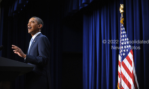 """United States President Barack Obama hosts Military Fathers and Children for a screening of """"Cars 2"""" in Advance of Father's Day in the South Court Auditorium, June 15, 2011, at the White House in Washington D.C..Credit: Olivier Douliery / Pool via CNP"""