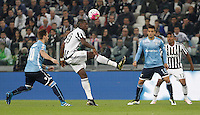 Calcio, Serie A: Juventus vs Lazio. Torino, Juventus Stadium, 20 aprile 2016.<br /> Juventus&rsquo; Paul Pogba, second from left, controls the ball past Lazio&rsquo;s Lucas Biglia, left, and Felipe Anderson during the Italian Serie A football match between Juventus and Lazio at Turin's Juventus Stadium, 20 April 2016.<br /> UPDATE IMAGES PRESS/Isabella Bonotto