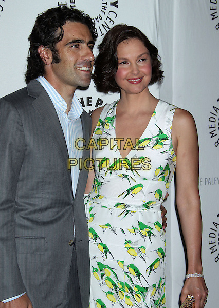 "Dario Franchitti, Ashley Judd.""Missing"" Premiere Screening presented by The Paley Center for Media held at The Paley Center For Media, Beverly Hills, California, USA..April 10th, 2012.half length white green print bird birds dress grey gray  .CAP/ADM/RE.©Russ Elliot/AdMedia/Capital Pictures."