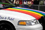 Colorful rainbow flag on a police car at gay and lesbian Pride parade in Toronto Canada 2008