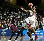 SIOUX FALLS, SD - MARCH 22: Quentin Ruff #1 from Ferris State takes the ball to the basket against Gach Gach #10 from West Texas A&M during their semifinal game at the 2018 Elite Eight Men's NCAA DII Basketball Championship at the Sanford Pentagon in Sioux Falls, SD. (Photo by Dave Eggen/Inertia)