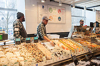 Seafood department in the new Whole Foods Market opposite Bryant Park in New York on opening day Saturday, January 28, 2017. The store in Midtown Manhattan is the chain's 11th store to open in the city. The store has a large selection of prepared foods from a diverse group of vendors inside the store.  (© Richard B. Levine)